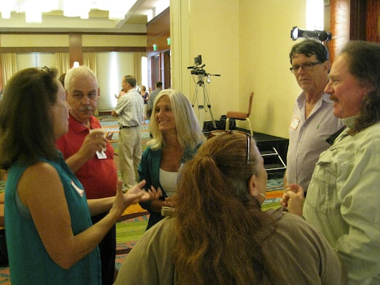Donnie Kinard (second from left), chief of the Regulatory Division and Tori White (third from left), deputy chief, chat with attendees during a break at the Fort Lauderdale, Florida Open House July 11.
