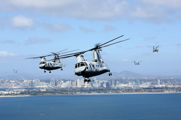 """U.S. Marines with Marine Medium Helicopter Squadron (HMM) 364, Marine Aircraft Group 39, 3rd Marine Aircraft Wing (MAW), fly CH-46E Sea Knight helicopters over San Diego, Calif., March 31, 2014. After 47 years of flying the CH-46, HMM-364, """"Flies the Barn"""", taking off and landing in unison and flying in mass formations, signifying the transition to the MV-22 Osprey. (U.S. Marine Corps photo by Sgt. Keonaona C. Paulo, 3rd MAW Combat Camera/Released)"""