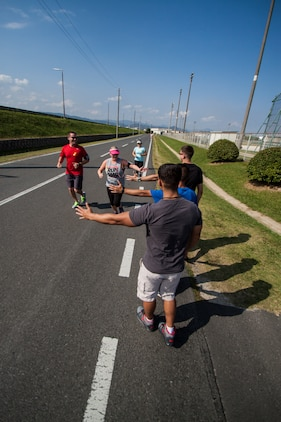 Marine Corps Air Station Iwakuni, Japan, residents participate in the 3rd annual Suicide Awareness 5K run/walk near Penny Lake fields aboard station, Sept. 27, 2014. The run was hosted by the Robert M. Casey Medical and Dental Health Clinic, the Marine Memorial Chapel and Behavioral Health. The event served as a way to help support and raise awareness of those who are, and who have been, affected by suicide.