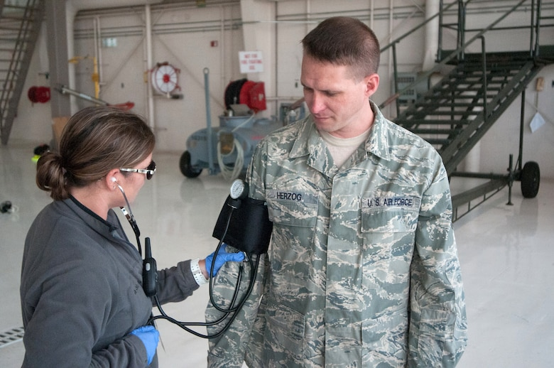 A nurse from the Louisville Veterans Affairs Medical Center checks the blood pressure of Staff Sgt. Kenneth Herzog, a vehicle operations dispatcher from the 123rd Logistics Readiness Squadron, during a National Disaster Medical System exercise at the Kentucky Air National Guard base in Louisville, Ky., on Sept. 9, 2014. The exercise is accomplished every three years. (U.S. Air National Guard photo by Master Sgt. Phil Speck)