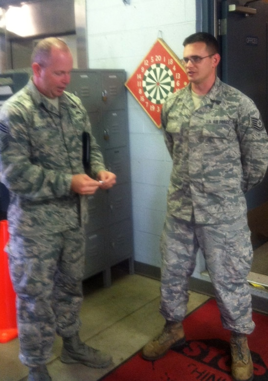 Command Chief Master Sgt. of the Air National Guard James Hotaling coins Tech. Sgt. Caleb Brumleve of the 109th Logistics Readiness Squadron during a visit to Stratton Air National Guard Base, New York, on Sept. 30, 2014. Brumleve was recognized by his leadership for being a stand out Airman. Hotaling visited Airmen throughout the base and also held an enlisted town hall meeting. He was at the base in preparation for an upcoming trip to Antarctica with the 109th Airlift Wing in support of Operation Deep Freeze. This will be his first trip to the ice. (U.S. Air National Guard photo by Chief Master Sgt. Amy Giaquinto/Released)
