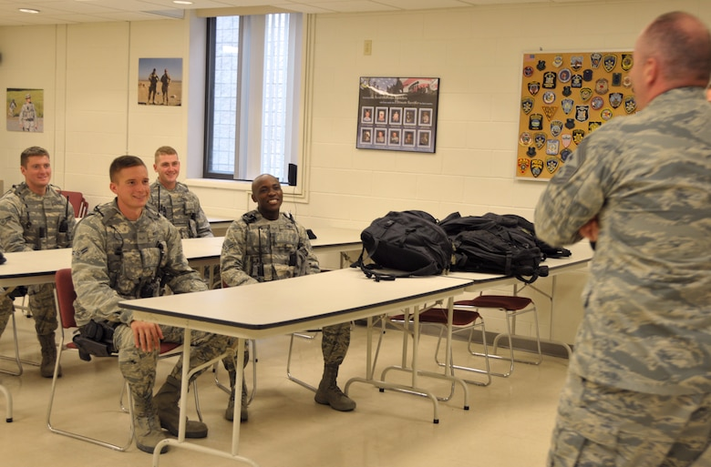 Command Chief Master Sgt. of the Air National Guard James Hotaling talks to a group of new Airmen with the 109th Security Forces Squadron during a visit to Stratton Air National Guard Base, New York, on Sept. 30, 2014. Hotaling visited Airmen throughout the base and also held an enlisted town hall meeting. He was at the base in preparation for an upcoming trip to Antarctica with the 109th Airlift Wing in support of Operation Deep Freeze. This will be his first trip to the ice. (U.S. Air National Guard photo by Tech. Sgt. Catharine Schmidt/Released)