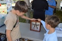 DAYTON, Ohio -- Visitors enjoyed educational programs such as trying on a parachute pack, demonstrating how an airplane flies and how rotary engines work, and making a flying a paper glider, during the Ninth WWI Dawn Patrol Rendezvous on Sept. 27-28, 2014. (U.S. Air Force photo)