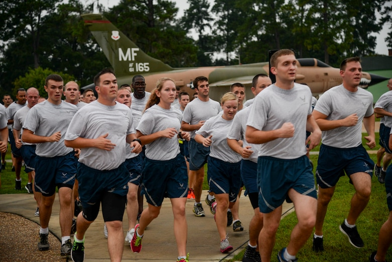 Airmen return to the President George W. Bush Air Park as they complete a 2.3-mile run for Comprehensive Airman Fitness day Sept. 30, 2014, at Moody Air Force Base, Ga. The run was held to emphasize the physical pillar of CAF day. (U.S. Air Force photo by Senior Airman Sandra Marrero/Released)