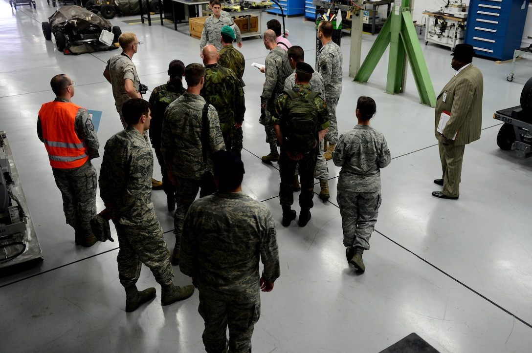 Inspectors from the Conventional Armed Forces in Europe treaty verification team walk through buildings during an exercise at Spangdahlem Air Base, Germany, Sept. 29, 2014. CFE inspections allow foreign countries to conduct an on-site inspection of U.S. installations. The inspections verify that the United States remains in compliance with treaty limits on equipment like tanks, armored-combat vehicles, heavy artillery, combat aircraft and attack helicopters. (U.S. Air Force photo by Airman 1st Class Kyle Gese/Released)