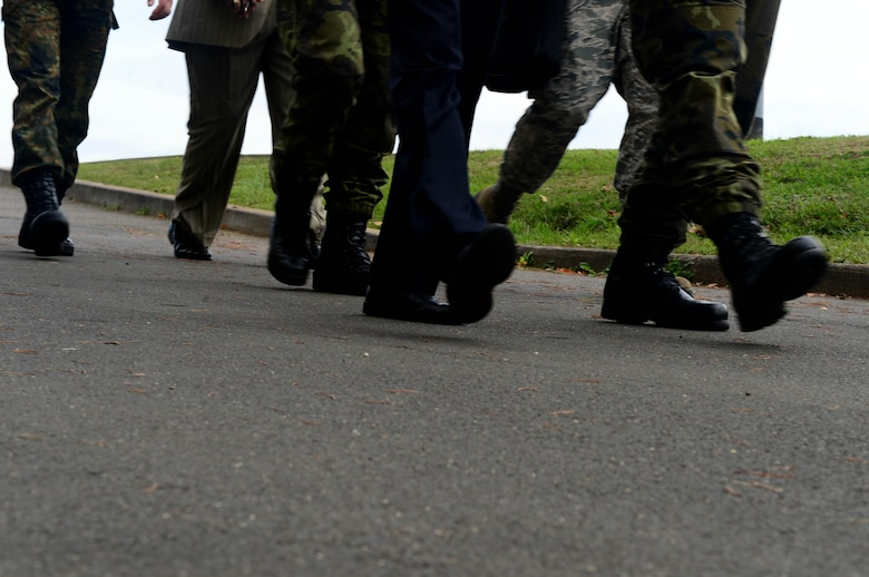 Inspectors from the Conventional Armed Forces in Europe treaty verification team walk to different buildings during an exercise at Spangdahlem Air Base, Germany, Sept. 29, 2014. The Czech Republic and France inspected the installation as part of a treaty verification exercise hosted by the 52nd Fighter Wing. (U.S. Air Force photo by Airman 1st Class Kyle Gese/Released)