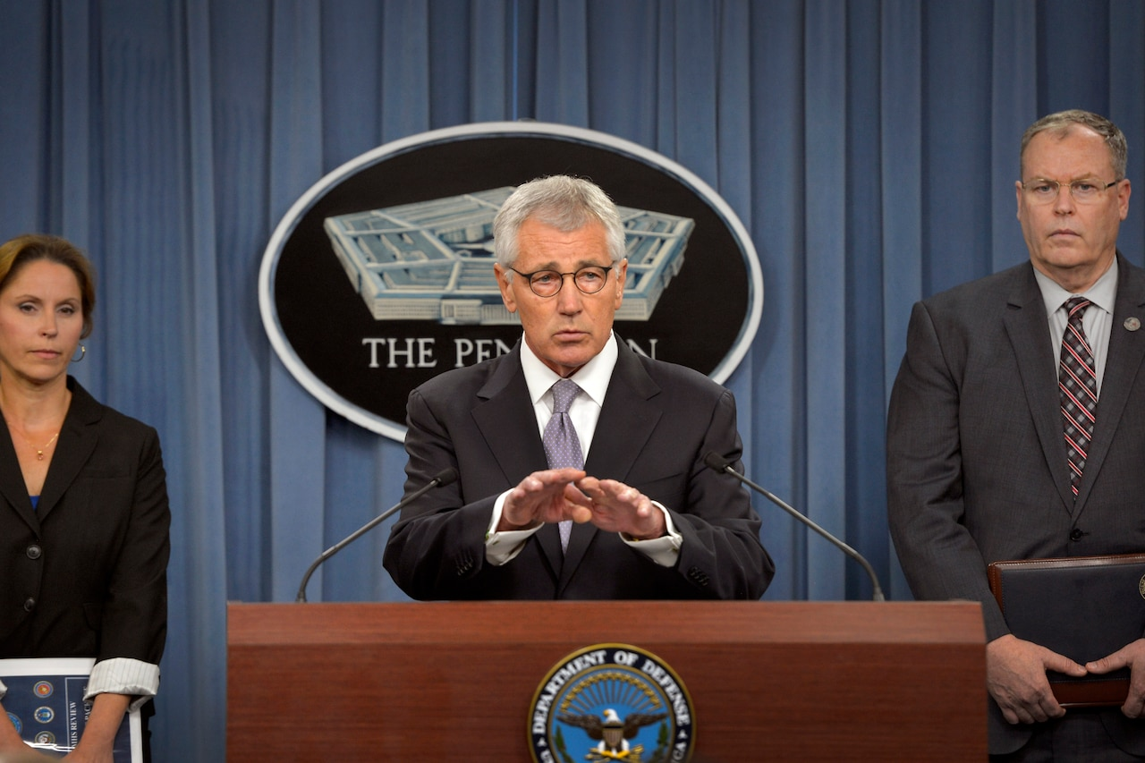 Defense Secretary Chuck Hagel and Deputy Defense Secretary Bob Work, right, and Dr. Laura Junor discuss the Military Health System during a briefing for reporters at the Pentagon, Oct. 1, 2014. DoD photo by Glenn Fawcett