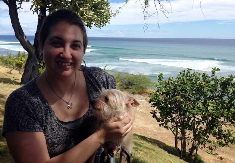 Staff Sgt. Amanda Dick enjoys the Pacific Ocean with her dog, Captain Jack Sparrow, four months after her last chemotherapy treatment, Sept. 13, 2014, at Diamond Head Lookout, Hawaii. She is now one of the estimated 2.8 million breast cancer survivors in the U.S. (Courtesy photo)
