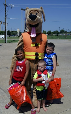 Bobber the Water Safety Dog and some of his pals at the Water Safety Day event July 13. The children received free life jackets from Safe Kids and other water safety-related goodies.