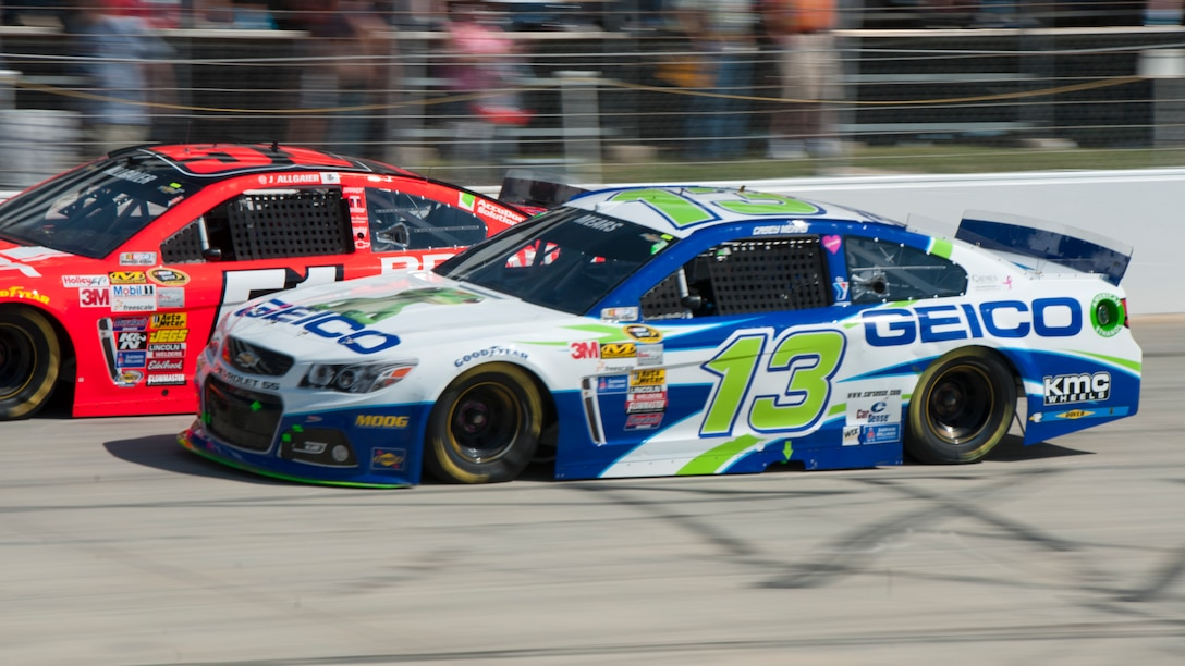 Casey Mears drives the Germain Racing No. 13 GEICO Chevy SS at the 2014 AAA 400, NASCAR Sprint Cup Series, Sept. 28, 2014, at Dover International Speedway in Dover, Del. Dover Air Force Base tail flashes can be seen on the lower quarter panels and the decklid (the rear trunk). (U.S. Air Force photo/Airman 1st Class Zachary Cacicia)