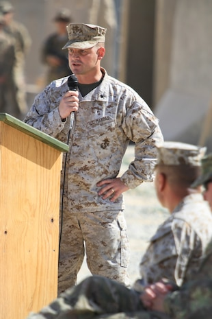 """Lieutenant Col. Seth Yost, right, commanding officer, 1st Battalion, 7th Marines, speaks during a transfer of authority ceremony aboard Tactical Base Dwyer, Afghanistan, Oct. 1, 2014. """"It's been a memorable deployment for 1st Battalion, 7th Marines. It's been inspiring to have been here as we help to write the final chapter of the Marine Corps' presence in Helmand province,"""" Yost said."""