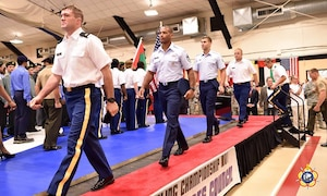 The US Armed Forces Wrestling Team marching during the Opening Ceremony of the 29th CISM World Military Wrestling Championship at Joint Base McGuire-Dix-Lakehurst (MDL), New Jersey 1-8 October