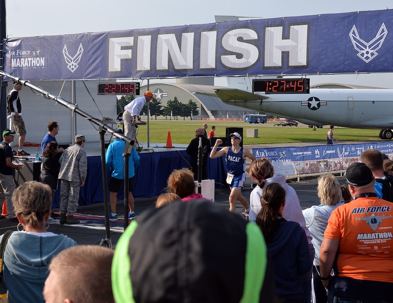 Staff Sgt. Joshua Johnson, Osan Air Base, Republic of Korea, finishes the Air Force Half Marathon, Wright-Patterson Air Force Base, Ohio, Sept. 20, 2014. Johnson was part of the Pacific Air Forces team that won 1st place in the half marathon Major Command team challenge. (Courtesy photo from Lois Johnson)