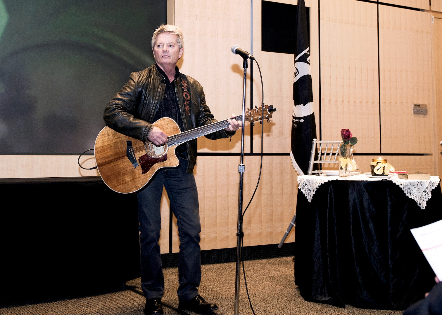 """Recording artist Jeff Senour performs his song, """"You Will Not Be Forgotten,"""" at the Legacy of Valor event at DIA Headquarters Sept. 29."""