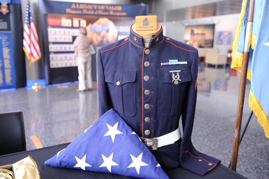 A historic Marine Corps uniform with the Medal of Honor ribbon is prominently showcased with U.S. flag as part of the Hispanic Medal of Honor Society's Legacy of Valor exhibit, on display at DIA Headquarters this week in celebration of Hispanic Heritage Month.  Photo by Army Lt. Col. Al Stout, OCC-2