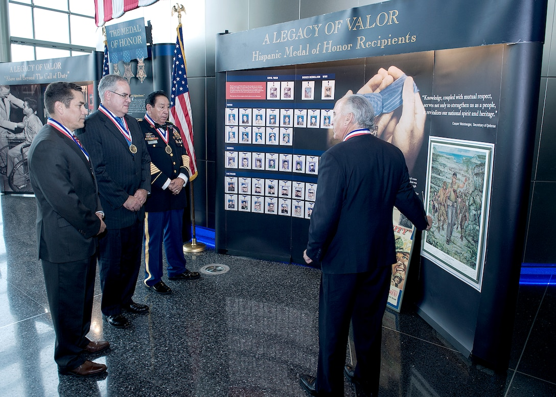 Hispanic Medal of Honor Society President Rick Leal, right, discusses the society's Legacy of Valor exhibit with DIA leadership Sept. 29.