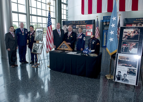 DIA's recipients of the Hispanic Medal of Honor Society's Legacy of Valor Medal pose in front of the exhibit with society president Rick Leal and Congressional Medal of Honor nominee Army Command Sgt. Maj. Ramon Rodriguez.