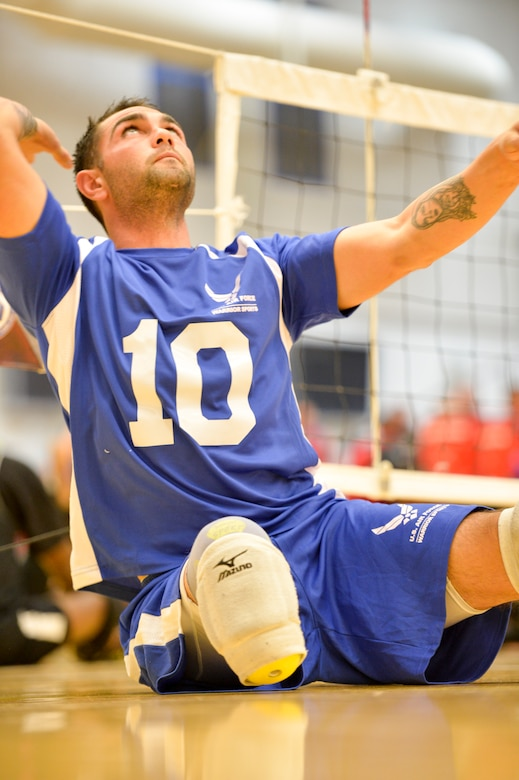 Retired Air Force Staff Sgt. Nicholas Dadgostar warms up prior to the start of the 2014 Warrior Games sitting volleyball bronze medal match between the Air Force and the Army Oct. 1, 2014, at the U.S. Olympic Training Center in Colorado Springs, Colo. The Army beat the Air Force in two sets, 25-20, 25-19. (U.S. Air Force photo/Staff Sgt. Devon Suits)