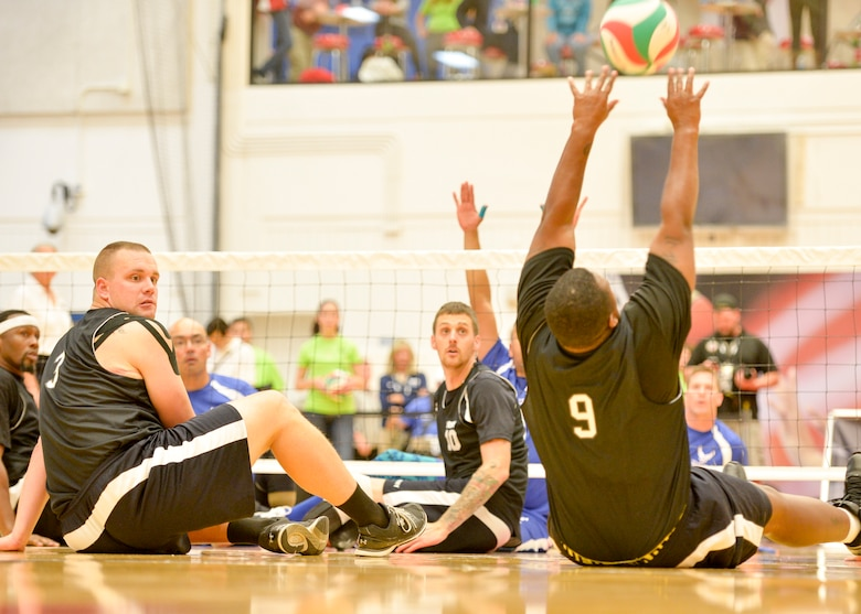 The Air Force and Army competed in the sitting volleyball bronze medal match at the 2014 Warrior Games Oct. 1, 2014, at the U.S. Olympic Training Center in Colorado Springs, Colo. The Army beat the Air Force in two sets, 25-20, 25-19. (U.S. Air Force photo/Staff Sgt. Devon Suits)