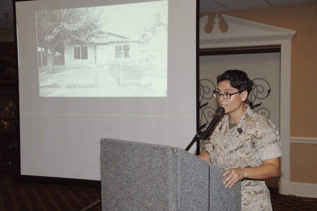 """Hispanic Heritage Month guest speaker Master Sgt. Alejandra Medina shares portions of her life through a slide presentation and country music song, """"The House that Built Me,"""" by Miranda Lambert, during a luncheon, Sept. 25."""