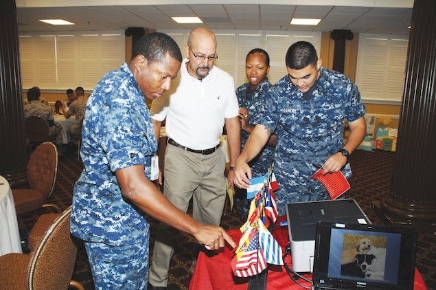 Unscrambling and correctly spelling a list of Hispanic countries as well as labeling flags for each one tests the knowledge of those attending the Hispanic Heritage Month Luncheon at the Town and Country Restaurant Grand Ballroom, Sept. 25.