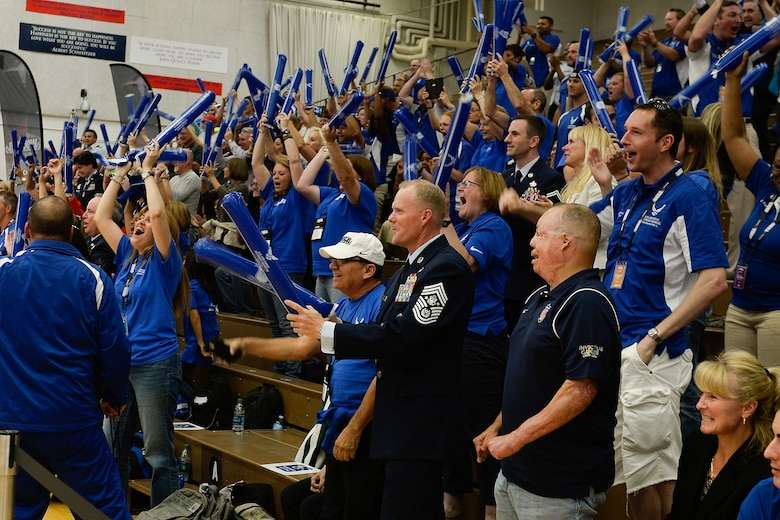 Chief Master Sgt. of the Air Force James A. Cody, along with fellow Air Force fans, cheers on Air Force athletes competing in a 2014 Warrior Games seated volleyball match Sept. 28, 2014, at the U.S. Olympic Training Center in Colorado Springs, Colo. The Warrior Games consist of athletes from the Defense Department, who compete in Paralympic-style events for their respective military branch. The goal of the games is to help highlight the limitless potential of warriors through competitive sports. (U.S. Air Force photo/Tim Chacon)