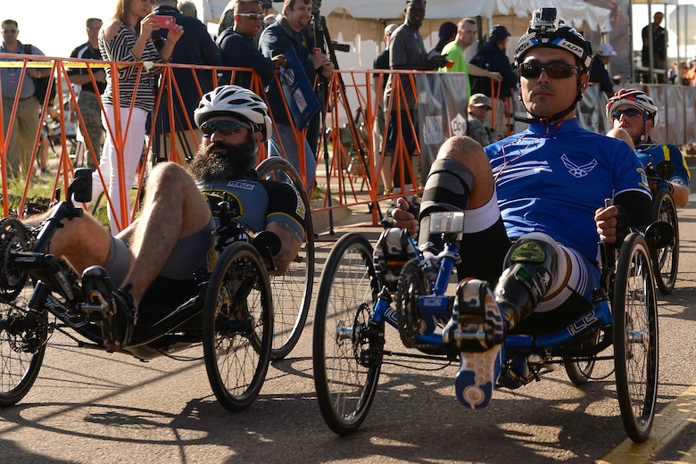 Air Force athlete Chris Aguillera, right, participates in a cycling race during the 2014 Warrior Games Sept. 29, 2014, at Fort Carson, Colo. The Warrior Games consist of athletes from the Defense Department, who compete in Paralympic-style events for their respective military branch. (U.S. Air Force photo/Tim Chacon)