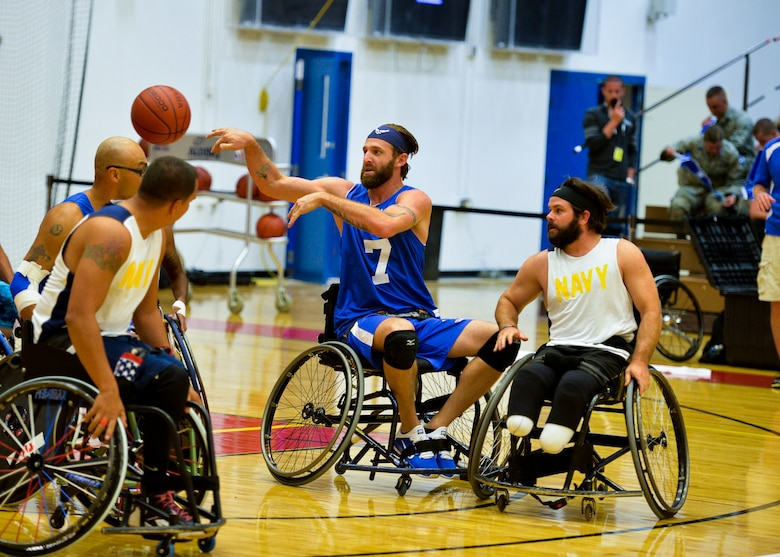 Retired Senior Airman Ryan Gallo passes the ball to an Air Force teammate during a wheelchair basketball game against Navy Sept. 29, 2014, during the 2014 Warrior Games at the U.S. Olympic Training Center in Colorado Springs, Colo. The Air Force lost 38-19. (U.S Air Force photo/Staff Sgt. Devon Suits)