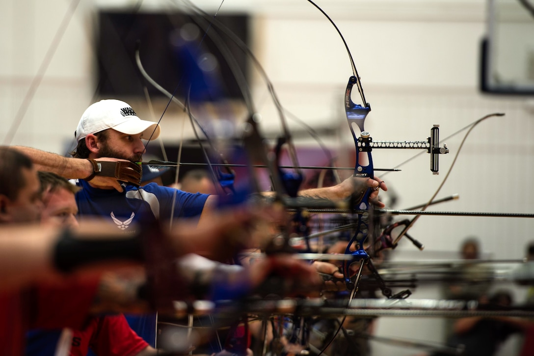 Air Force athlete Ryan Gallo aims his bow during an archery qualification match during the 2014 Warrior Games Oct. 1, 2014, at the U.S. Olympic Training Center, Colorado Springs, Colo. The Warrior Games consist of athletes from the Defense Department, who compete in Paralympic-style events for their respective military branch. The goal of the games is to help highlight the potential of warriors through competitive sports. (U.S. Air Force photo/Airman 1st Class Scott Jackson)