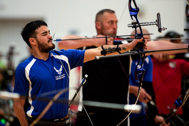 Air Force athlete Daniel Crain aims at his target in an archery qualification round during the 2014 Warrior Games Oct. 1, 2014, at the U.S. Olympic Training Center in Colorado Springs, Colo. The Warrior Games consist of athletes from the Defense Department, who compete in Paralympic-style events for their respective military branch. The goal of the games is to help highlight the potential of warriors through competitive sports. (U.S. Air Force photo/Airman 1st Class Scott Jackson)