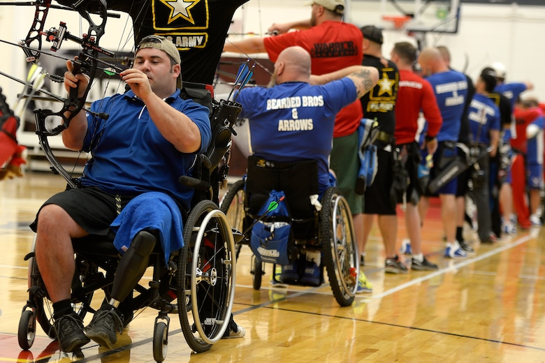Air Force athlete Seth Pena, left, competes in archery during the 2014 Warrior Games Oct. 1, 2014, at the U.S. Olympic Training Center in Colorado Springs, Colo. The Warrior Games consist of athletes from the Defense Department, who compete in Paralympic-style events for their respective military branch. The goal of the games is to help highlight the potential of warriors through competitive sports. (U.S. Air Force photo/Tim Chacon)