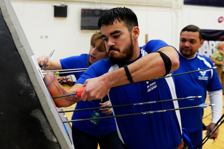 Air Force athlete Daniel Crane retrieves his arrows from his target during the 2014 Warrior Games Oct. 1, 2014, at the U.S. Olympic Training Center in Colorado Springs, Colo. The Warrior Games consist of athletes from the Defense Department, who compete in Paralympic-style events for their respective military branch. The goal of the games is to help highlight the potential of warriors through competitive sports. (U.S. Air Force photo/Tim Chacon)