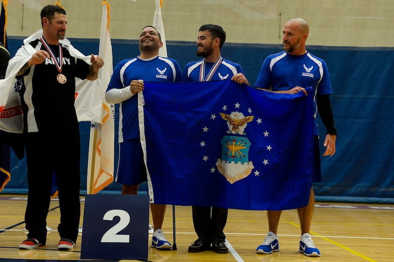 The Air Force archery team receives the silver medal during the 2014 Warrior Games Oct. 1, 2014, at the U.S. Olympic Training Center Colorado Springs, Colo. The Warrior Games consist of athletes from the Defense Department, who compete in Paralympic-style events for their respective military branch. (U.S. Air Force photo/Tim Chacon)