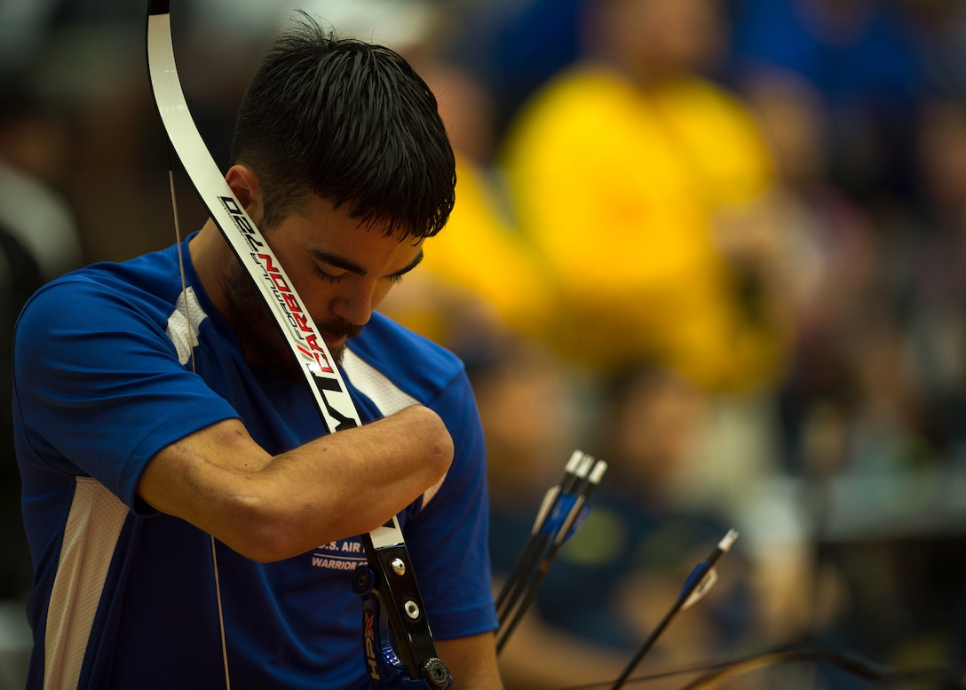 Air Force athlete Daniel Crane holds his bow to retrieve an arrow during the archery portion of the 2014 Warrior Games Oct. 1, 2014, Warrior Games at the U.S. Olympic Training Center, Colorado Springs, Colo. . The Warrior Games consist of athletes from the Defense Department, who compete in Paralympic-style events for their respective military branch. The goal of the games is to help highlight the limitless potential of warriors through competitive sports. (U.S. Air Force photo/Senior Airman Justyn M. Freeman)