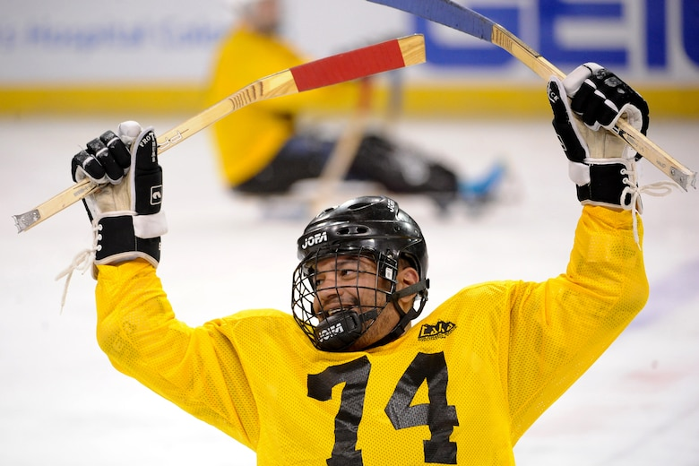 Master Sgt. Axel Gaud-Torres reacts to playing a game of sled hockey Oct. 2, 2014, at the World Arena in Colorado Springs, Colo. Several athletes competing in the 2014 Warrior Games, like Torres, played sled hockey with local wounded warriors as a demonstration before the Los Angeles Kings and Colorado Avalanche professional hockey game. (DOD News photo/EJ Hersom)