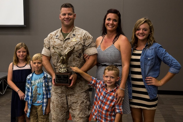 U.S. Marine Gunnery Sgt. Mickey Eaton poses with his family after receiving the Navy and Marine Corps Association Leadership Award aboard Camp Pendleton, Calif., Sept. 26, 2014. Eaton, from Chicago, Ill., is the assistant operations chief for Bravo Company, 1st Reconnaissance Battalion. (U.S. Marine Corps photo by Cpl. Anna Albrecht/Released)