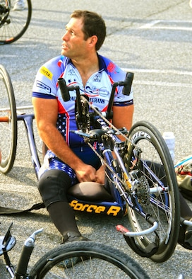 Retired Staff Sgt. Ryan Pinney adjusts the hand gears on his recumbent bike before competing in the 2014 U.S. Army Warrior Trials cycling event June 15, 2014, in West Point, N.Y. (Photo /Benny Ontiveros)