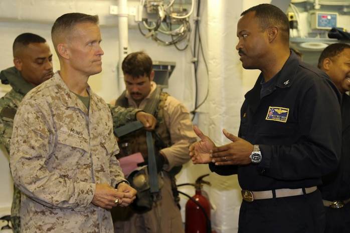 Brig. Gen. Carl Mundy, commander, Combined Task Force 51, speaks with Capt. Alvin Holsey, commanding officer, USS Makin Island before departing the Makin Island, Sept. 29.  Mundy visited the Marines and sailors deployed with the Makin Island Amphibious Ready Group (ARG) and the embarked 11th Marine Expeditionary Unit (MEU) in support of maritime security operations and theater security cooperation efforts in the U.S. 5th Fleet area of responsibility.  (U.S. Marine Corps photo by Cpl. Laura Y. Raga/ RELEASED)