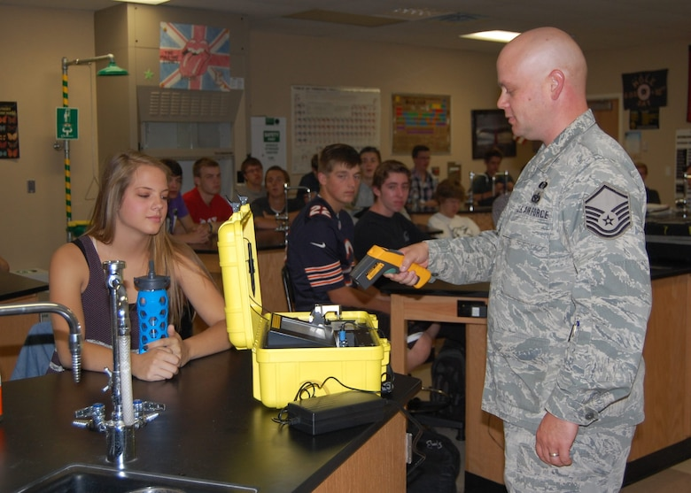 Master Sgt. Jared Hiles, emergency manager, 140th Wing, demonstrates how the equipment he uses for his job is based on the principles the high school students are learning about in chemistry class at Rock Canyon High School Sept. 23. Their science teacher, Mr. Bart Blumberg, is also a Traditional Guardsmen and Staff Sergeant in the 140th Maintenance Squadron. (Air National Guard Photo by Capt. Kinder Blacke)