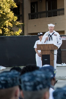 Master-at-Arms 1st Class Justin Treml speaks at a memorial dedication ceremony in honor of Master-at-Arms 2nd Class Mark Mayo Oct. 3, 2014 at the Naval Technical Training Center Lackland. Mayo died in the line of duty in March 2014 while stationed aboard the USS Mahan (DDG-72) at Norfolk Naval Station, Va. For his actions that day, Mayo was posthumously awarded the Navy Marine Corps Medal, the second-highest non-combat decoration awarded for heroism. (U.S. Air Force photo by Joshua Rodriguez/Released)