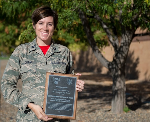 Capt. Stephanie Doane, 366th Medical Operations Squadron urgent care center clinical nurse, holds the 2014 Juanita Redmond award Oct. 3, 2014, at Mountain Home Air Force Base, Idaho. The award is the Air Force Association's highest honor in the field of nursing. (U.S. Air Force photo by Airman 1st Class Brittany A. Chase/RELEASED)