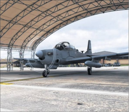 An A-29 Super Tucano taxis on the flightline Sept. 26 at Moody Air Force base, Ga. The Afghan A-29 Light Air Support training mission will begin at Moody in February 2015, and the A-29 will provide offensive and defensive aerial fires capability and reconnaissance and surveillance capability within Afghanistan. (Air Force photo by Airman 1st Class Dillian Bamman)