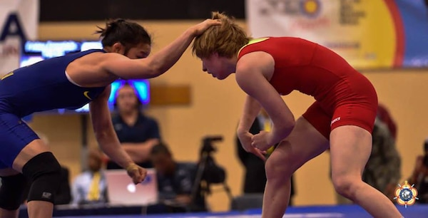 Army Sgt. Whitney Condor (red) against Hui Li of China during the 2014 CISM World Military Wrestling Championship at Joint Base McGuire-Dix-Lakehurst, New Jersey on 3 October 2014.
