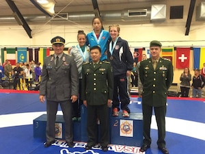 Army Sgt. Whitney Condor takes silver in the Women's 53kg Freestyle Division during the 2014 CISM World Military Wrestling Championship at Joint Base McGuire-Dix-Lakehurst, New Jersey on 3 October 2014.  Gold - Hui Li (China); Silver- Whitney Conder (USA); Bronze- Jaqueline Schellin (Germany)