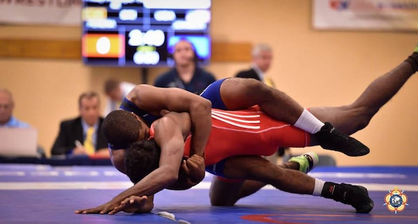 Army PFC Jamel Johnson (blue) turns his opponent during his victory over Chamara Perera (Sri Lanka), 16-5 in the Men's Freestyle 65kg division. Johnson place 5th in his division during the 2014 CISM World Military Wrestling Championship at Joint Base McGuire-Dix-Lakehurst, New Jersey on 3 October 2014.