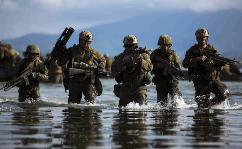 Philippine and U.S. Marines assault the beach during a simulated raid during Amphibious Landing Exercise 15 in Palawan, the Philippines, October 2, 2014. PHIBLEX is an annual, bilateral training exercise conducted by the Armed Forces of the Philippines alongside U.S. Marine and Navy forces focused on strengthening the partnership and relationships between the two nations across a range of military operations including disaster relief and complex expeditionary operations. The U.S. Marines are with Company L,  Battalion Landing Team 3rd Battalion, 5th Marines, 31st Marine Expeditionary Unit, 3rd Marine Expeditionary Brigade.
