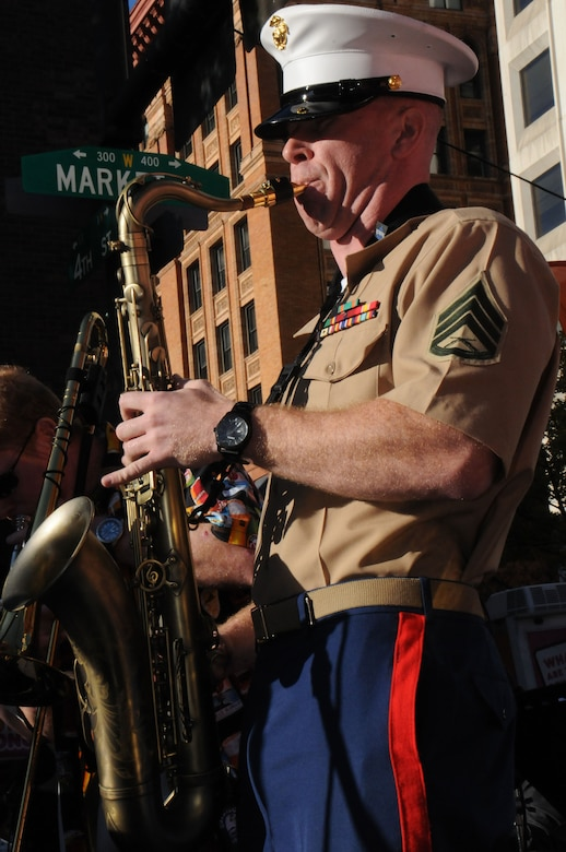 Staff Sgt. Jebediah Koch from the recruiting station Harrisburg with the 1st Marine Corps, plays the saxophone during the Fox 29 Salutes the Military Day Sept. 26, 2014, Philadelphia, Pa. The event showcased each military branch, including active-duty, Reserve and National Guard components. (U.S. Air National Guard photo by Tech. Sgt. Andria J. Allmond/Released)