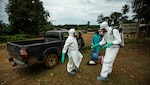 A USAID safe-burial team trained to handle the bodies of those infected with Ebola works in Monrovia, Liberia, Sept. 26, 2014. USAID photo by Morgana Wingard