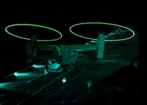 An MV-22 Osprey displays static lights while performing operational testing during night vision device flight operations aboard the amphibious assault ship USS Makin Island Sept. 18, 2014, while underway in the Persian Gulf. The lights make the rotors visible during nighttime takeoffs and landings. U.S. Navy photo by Petty Officer 3rd Class Robin W. Peak