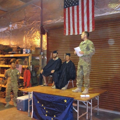 DJIBOUTI, Africa -- Chief Master Sgt. Paul Barendregt delivers the opening remarks at an intimate graduation ceremony here for deployed members, Master Sgt. Kris Abel and Staff Sgt. Nate Greene.(From l-r, Maj Komatsu, MSgt Kris Abel, SSgt Nate Greene, and CMSgt Paul Barendregt.)